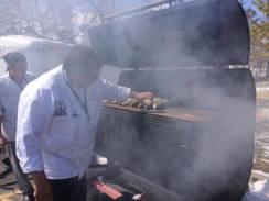 Smoking whole lake trout at the Food Summit at the Radisson, 2014.